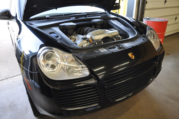 2006 porsche Cayenne S Turbo 955 water leak plastic coolant pipe replacement install aluminum 1 engine bay motor underhood - Copy