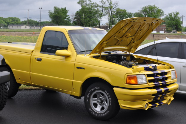 ford ranger colorful yellow purple stripes hood open pick up truck