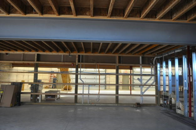 iron gate motor condo inside wood work under contruction ceiling flooring garage