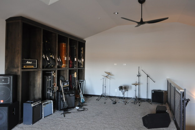 iron gate motor condo third floor guitar collection customized amps shelf drum set