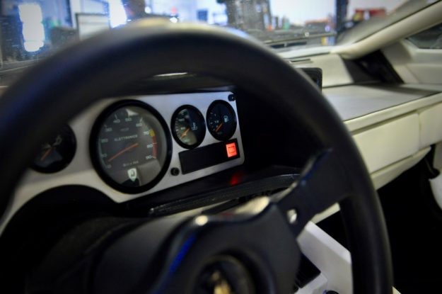 A Lamborghini Battery Light on the dash of a Countach