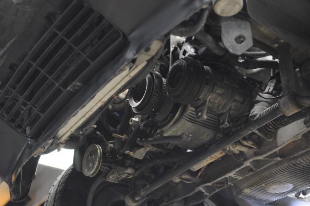 1983 porsche 924 s water pump replacement coolant leak timing belt tension oil 944 under car crankshaft pulley