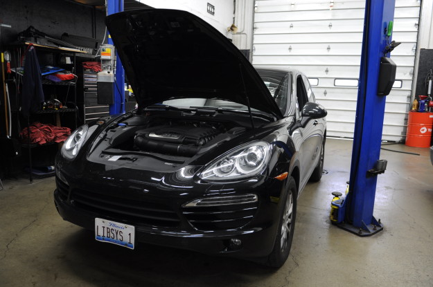 2011 Porsche Cayenne 3.6 direct injected VR6 6 cylinder oil change filter service black front headlights and hood on lift
