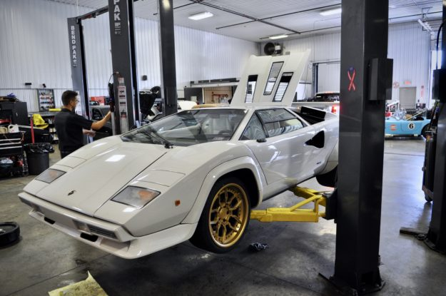 The Battery light came on the dash of this beautiful white 1987 Lamborghini Countach, so our mechanics put it up on the lift for the repair!